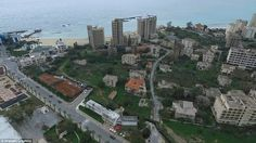 High-rise hotels are crumbling and the land has been reclaimed by overgrown vegetation in Varosha, a suburb of Famagusta, Cyprus