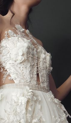 Open back bodice embroidered with silver seed beads, handmade 3D flowers, #Swarovski crystals and pearls. French lace and soft Italian tulle layered skirt.