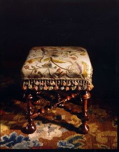 An important, late-17th century, upholstered, yew stool