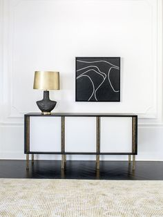 KELLY WEARSTLER | MELANGE CREDENZA. Burnished brass legs and solid, luxe wood with a credenza accented in combed plaster.