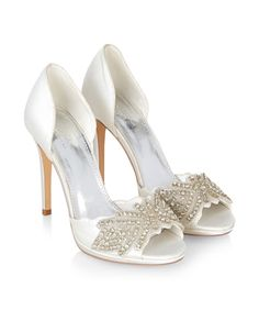 Our satin-covered Lola bridal shoes are encrusted with sparkling jewels, and…