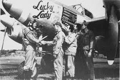 Lt Arthur W. Heiden and ground crew photographed with his 20th FG P-38J in early 1944.