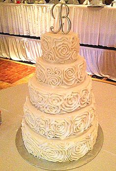 Custom Five Tiered Wedding Cake With Ercream Rosettes Covering Each Tier Made By Creations In