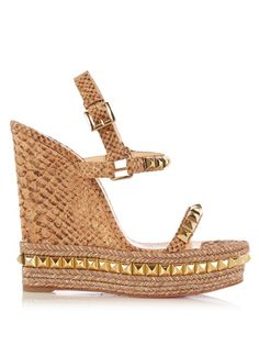 Christian Louboutin's Cataclou wedge sandals are a luxurious update on an espadrille. Gold-tone studs decorate the slim straps and rope-trimmed sole, while the cork wedge heel is covered in an exotic python print. Wear them to bring glamour and sophistication to a demure blouse and midi skirt.