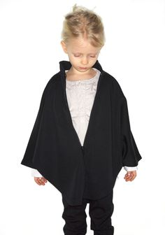 I'm thinking a knitted version of this would be awesome!  Tuss / Tomasin Poncho  |   La Garçonne