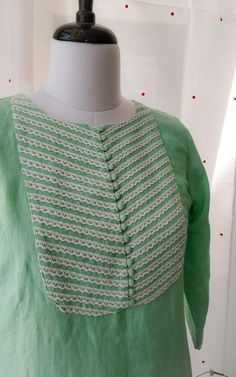 Pastel Green Pure Linen Kurta Crochet lace detailing on yoke and sleeves Potli buttons detailing at centre Straight fit with side slits
