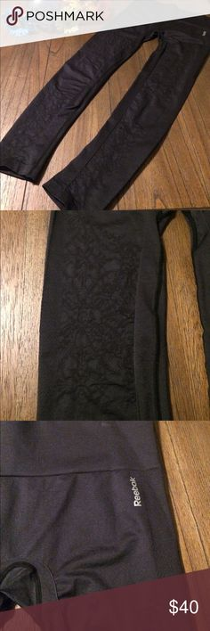 Reebok Tights EUC--they didn't fit--Reebok tights. Black with pattern on thighs and lower legs. Reebok logo on left hip. They are marked size XL--but there is NO WAY--and I mean absolutely NO WAY--that these will fit an XL. A fit Large would be more appropriate to wear. Waist measures 14 1/2 when flat without stretch. While the fabric is stretchy--it has limits. Perfect for dancers. Waist can be folded over to be more of a low waist fit. Reebok Pants Leggings