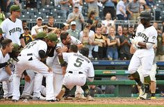 Francisco Cervelli Photos Photos - Andrew McCutchen #22 of the Pittsburgh Pirates is met by teammates at home plate after hitting a walk off home run in the ninth inning to give the Pittsburgh Pirates a 4-3 win over the Arizona Diamondbacks at PNC Park on May 29, 2017 in Pittsburgh, Pennsylvania. MLB players across the league are wearing special uniforms to commemorate Memorial Day. - Arizona Diamondbacks v Pittsburgh Pirates