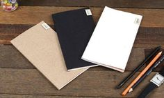 Tall Handy Notebook -The naturally textured card cover softens the subtly embossed Oblack branding on this handy sized notebook. Despite a pop of orange in the cover lining, this notebook contains minimalist white blank pages and a set of kraft sticky labels.    http://www.pagemarker.co.uk/O-Black-Tall-Handy-Notebook/dp/B00A8JN226#