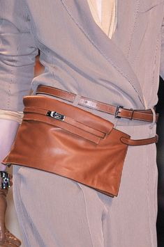 with jeans and boots....the most jazzy fanny pack i have ever seen...and i want it lol