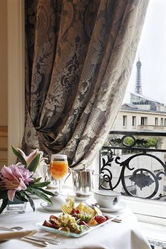 Breakfast at Hotel Raphael, Paris with Eiffel Tower in background.