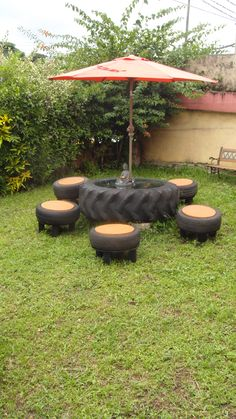 Picnic table and stools repurposed from tires.