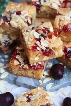 Thick and Gooey Bakewell Blondies with Ground Almonds, Raspberry Jam, and Flaked Almonds on top! Heaven in every Bakewell Bite. Tray Bake Recipes, Tart Recipes, Brownie Recipes, Baking Recipes, Dessert Recipes, Baking Ideas, Cheesecake Recipes, Dessert Ideas, Cake Ideas