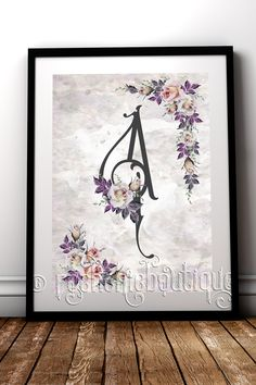 Personalised finishing touches really make a difference, this beautiful floral Monogram fine art print is perfect for a Nursery or little girls room #RockChicBoutique #Monogram #NurseryDecor #NewBaby #WallArt