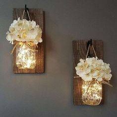 Product Description: Rustic Mason Jar Wall Sconce with LED Fairy Lights & Choice of Artificial Hydrangeas Flowers for Country Home Bedroom wedding Cafe Bar Party Wall Decoration Features: This is the perfect wall decor as you can switch out the flowers a Mason Jar Wall Sconce, Hanging Mason Jars, Rustic Mason Jars, Mason Jar Lighting, Mason Jar With Lights, Mason Jar Bathroom, Mason Jar Kitchen Decor, Decorating With Mason Jars, Budget Decorating