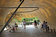How about drinking that morning coffee in the new Serpentine Pavillion?  More info: http://teatimeinwonderland.co.uk/lang/en/2014/08/06/serpentine-gallery-pavillion-2014