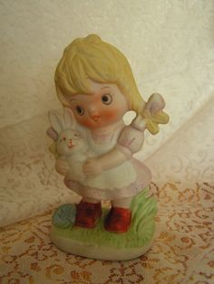 girl with bunny figurine in vintage