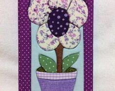 Agenda de bolsa roxa vaso de flor