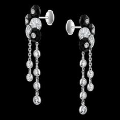 Piaget. Limelight sequin motif earrings in 18K white gold set with 46 brilliant-cut diamonds (approx. 1.57 ct) and 6 carved onyx stones.