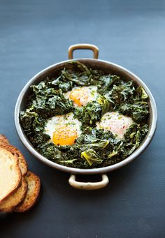 This simple, rustic dish is both healthy and hearty. First, kale is braised with fragrant garlic, green onions and lemon juice, then protein-rich eggs are then nestled into the bed of kale, where t...