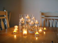 VVery simple centerpieces. They're actually glasses that I purchased at Ikea and will be sitting on top of a mirror. The glasses will be filled with water at various heights and floating candles.