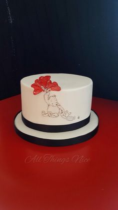 A Simple Vintage Winnie The Pooh themed cake, hand sketched Winnie the Pooh with wafer paper red balloons. A pretty simple cake ❤️