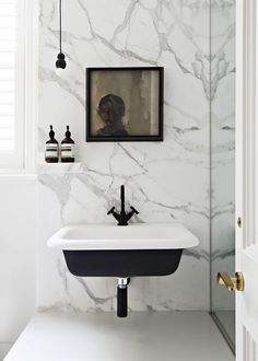 Black Wall mount sink, grey and white marble