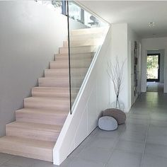 Glass bannister and minimalist under stair storage Interior Design Examples, Interior Design Inspiration, Basement Stairs, House Stairs, Attic Stairs, Glass Stairs, Glass Stair Railing, Glass Bannister, Modern Stairs