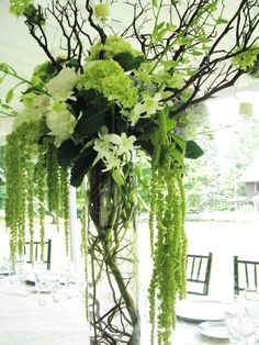 Tall cyclinder with manazanita branches, orchids, hydrangeas, hanging green amaranthus and hanging votives  - See More Great Ideas from DriedDecor.com