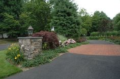 Our New Jersey custom stonework designers orchestrate the design and construction of all the hardscape elements for your property. Driveway Entrance Landscaping, Front House Landscaping, Front Yard Fence, Landscaping With Rocks, Outdoor Landscaping, Landscaping Ideas, Driveway Gate, Driveway Apron, Acreage Landscaping