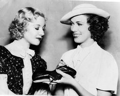 Eleanor Powell autographing a pair of her dancing shoes for Una Merkel, 1937