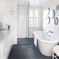 gray and white floor tile renovated white bathroom via my ideal home black bathroom floor grey floor white subway tile Black Bathroom Floor, Black Tile Bathrooms, Blue Bathroom Vanity, Small Basement Bathroom, Bathroom Cost, Add A Bathroom, Gray And White Bathroom, Small Space Bathroom, Bathroom Plumbing
