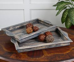 Heavily distressed, dark blue and aged ivory serving trays with natural wood undertones. Sizes: Sm-22x13x2, Lg-23x15x2