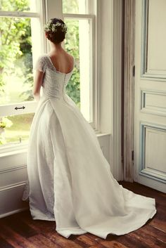 Photo of the bride looking out the window