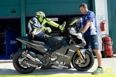 Rossi dismounts his 2014 ride after testing.