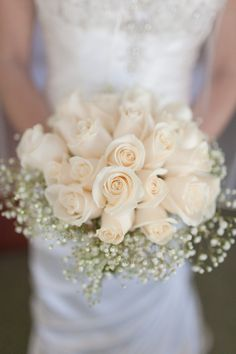 White roses and baby's breath bouquet.  Photo:  Bob Care Photography