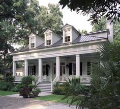 A lowcountry cottage designed by Historical Concepts, award-winning architects who specialize in designing traditional homes. This white house with a deep front porch and black shutters exemplifies classic Southern style. This is my dream home! Historical Concepts, Traditional Exterior, Traditional Homes, Southern Homes, Southern Charm, Southern Cottage, Southern Home Plans, Lowcountry House Plans, Low Country Homes