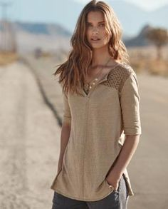 Odette top - Wrap London - This longer length linen jersey top has a lovely contrast coloured, broderie anglaise panel across the shoulders. With neat fitting, elbow-length sleeves and deep splits at the hemline, this is a lovely holiday piece. 100% linen, Trim 100% cotton.