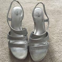 Silver heels Silver glitter heels. Worn once. Still have the original box. Apt. 9 Shoes Heels