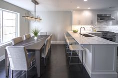 See the versatility of CKM Home Design through their photo gallery: Cape Code Redesign, Charmer, Kitchen and Dining room renovation and a new construction illustration. Carrie, Kitchen Dining, Dining Rooms, Dining Room Design, New Construction, Condo, House Design, Modern, Table