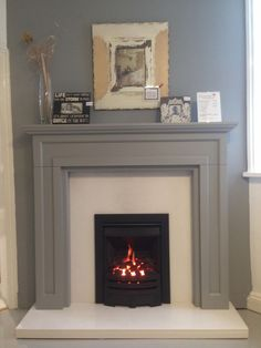The Bossart #firesurround in #farrowandball Manor House Grey. Can be painted in any colour. Also with white #crystalmarble and a Virage HE Gas Fire #fireplaceideas