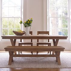 Our Sumatra cross leg dining table is handmade by artisans from rustic reclaimed teak in Indonesia.