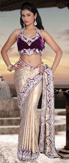 exhilarating Gold and Purple bridal Silk saree with velvet blouse