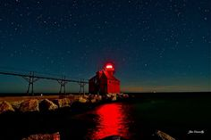 """Big Red's Glow by Jim Connolly on Capture Door County // The glow of Big Red really shines, because it was """"painted"""" only by the moon light. A special thanks again to Laura, Rose, John and Deborah for braving the spiders."""