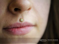 Philtrum piercing by APP member Dan Steinbacher of Saint Sabrina's.