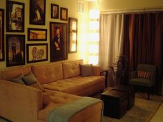 A small apartment living room, great tuffted sectional and wall art