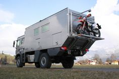 Action Mobil vehicle with hydraulic lift for motorbike stand. Fischer Panda PVK-UK generator mounted below chassis.