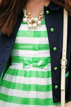 Lilly Pulitzer, preppy, long navy coat, crisp green and white striped dress, pearl statement necklace.