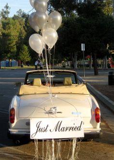I love this one... The balloons make it so happy and fun.  Rolls Royce Corniche convertible. #weddingcar, #getawaycar