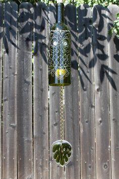 Hey, I found this really awesome Etsy listing at https://www.etsy.com/listing/107605779/wine-bottle-windchime-owl-locket